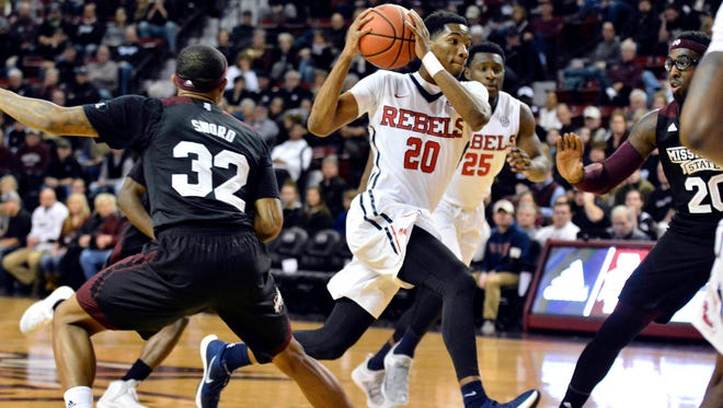 Guard Donte Fitzpatrick-Dorsey (20) drives toward the basket last Saturday against Mississippi State. He hopes to build off the game, which was his first start with the Rebels.