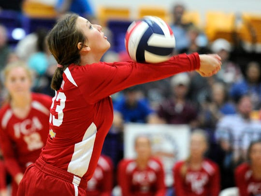 South team's Abby McCoy passes the ball during the
