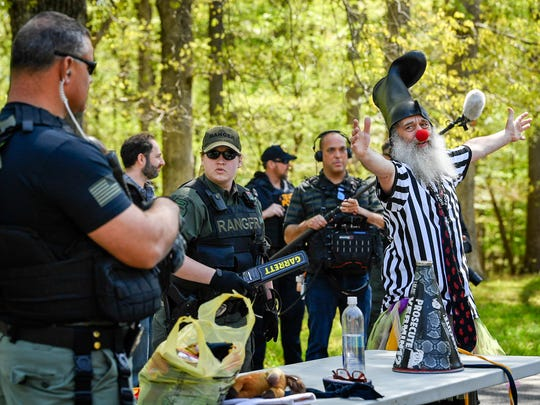 Vermin Supreme, right goes through the security checkpoint with everyone else as they gather to protest the annual American Renaissance conference at the Montgomery Bell State Park in Burns, Tenn., on April 28, 2018.