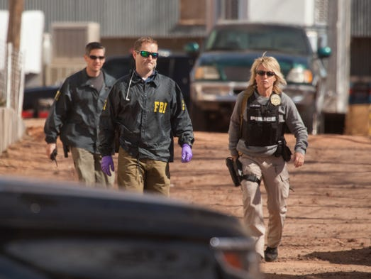 Agents from the FBI and other law enforcement make