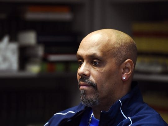 Former Eastside High School assistant basketball coach Alberto Maldonado, shown Monday during an interview along with his lawyer, was fired from his coaching duties as a result of an investigation into the team's use of overseas players.