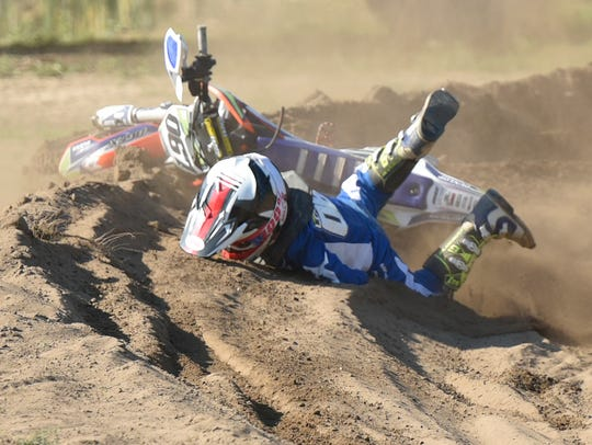 Logan Lockwood, an 11-year-old South Lyon resident, wipes out on the loose dirt on a curve.
