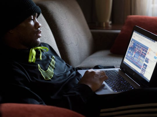 Raymon Henry watches a professional boxing match on youtube in his hotel room in Omaha, Neb. on Sunday, May 13, 2018. Henry was in Omaha representing team Indiana in the National Golden Gloves competition.