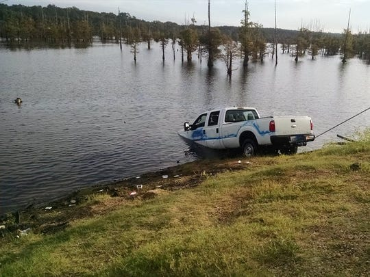 A truck that belongs to the town of Montgomery in Grant Parish is pulled out of Black Lake in Natchitoches Parish early Tuesday morning. An investigation is continuing.