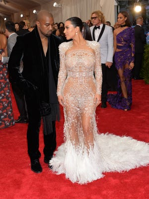 Kanye West, left, and Kim Kardashian arrive at The Metropolitan Museum of Art's Costume Institute benefit gala.