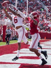 Alabama defensive back Saivion Smith (8) breaks up