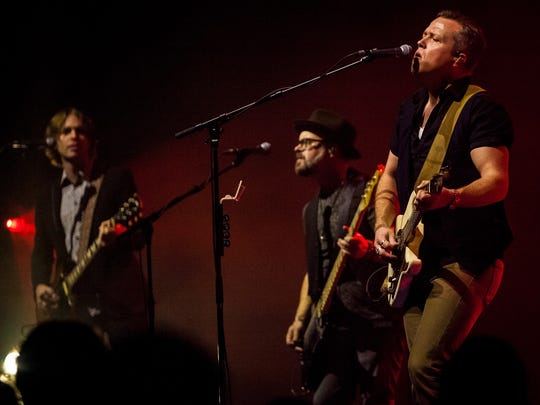 Jason Isbell performs with 400 Unit members Sadler Vaden, left, and Jimbo Hart, middle, Saturday at Old National Centre.