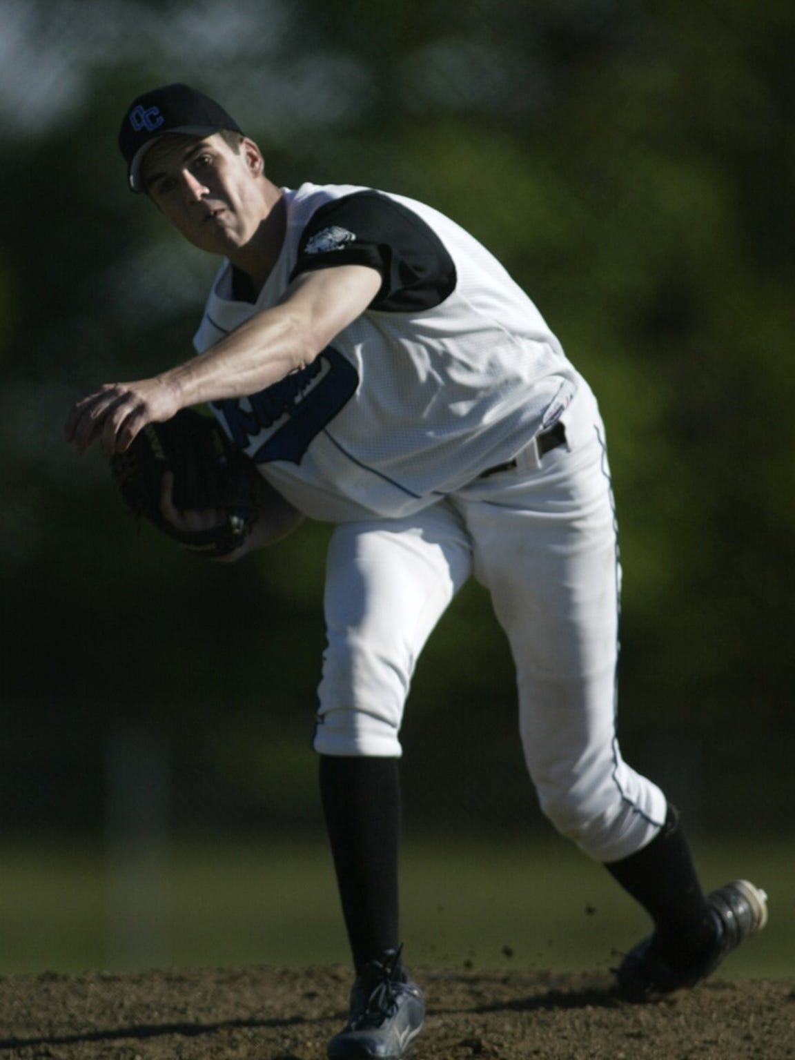 Oak Creek's Tony Butler throws a pitch during the 2004