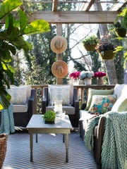 Thanks to a pergola overhead, this outdoor lounge remains cool and shaded from the sun.