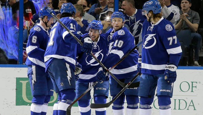 Tampa Bay Lightning left wing Brenden Morrow (10) celebrates with teammates, including, Victor Hedman (77) of Sweden, Brian Boyle (11) Anton Stralman (6) of Sweden, and J.T. Brown (23) after scoring against the Florida Panthers during the first period of an NHL hockey game Tuesday, March 24, 2015, in Tampa, Fla.