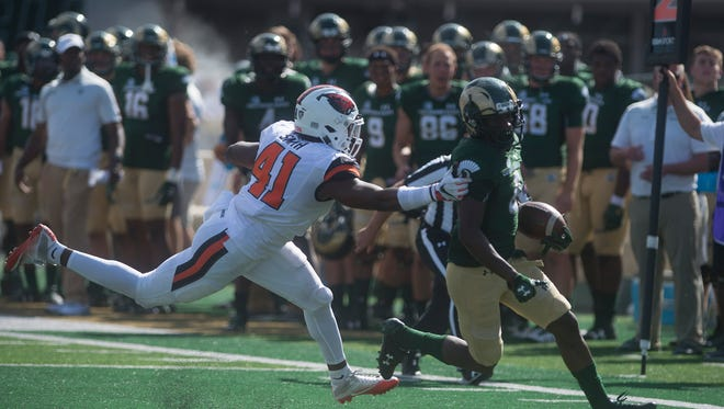 CSU wide receiver Detrich Clark gets away from Oregon State linebacker Shemar Smith during a touchdown run in the season opener at the on-campus stadium on Saturday, August 26, 2017.