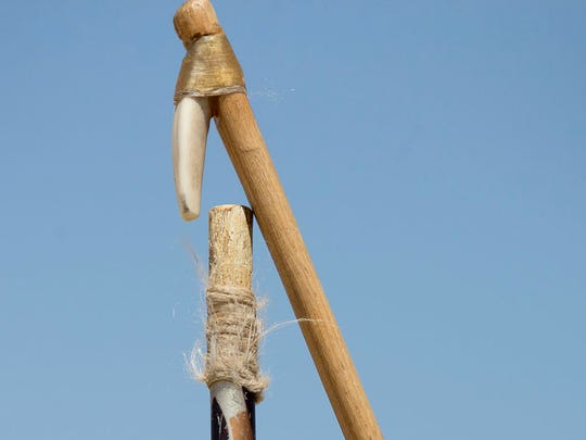 An atlatl has a spurn on the end that fits inside of the end of an atlatl dart. Pat Shannahan/The Arizona Republic
