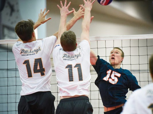 Susquehannock's Quinlan Kauffman (15) attempts a kill while playing for the Yorktowne Volleyball Club 18 Orange team against blockers Raymond Cascio (14) and Gary Treser (11) from Pittsburgh Black on Thursday, July 2, 2015 at the the USA Volleyball Boys' Junior National Championships in Columbus, Ohio.