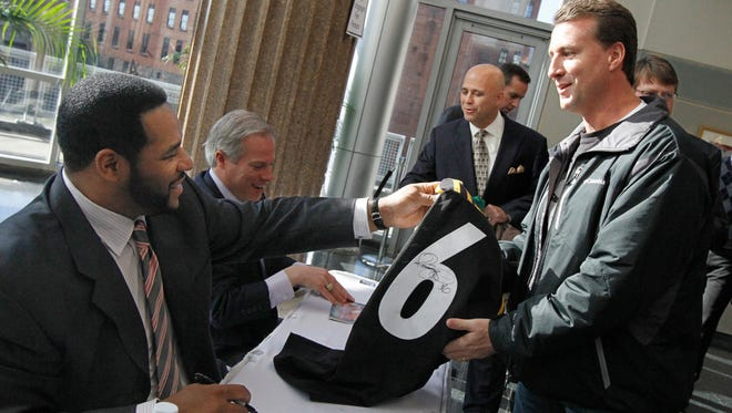 Pittsburgh Steelers star running back Jerome Bettis, left, signs a football jersey for fan Rick Alloco of Greece.