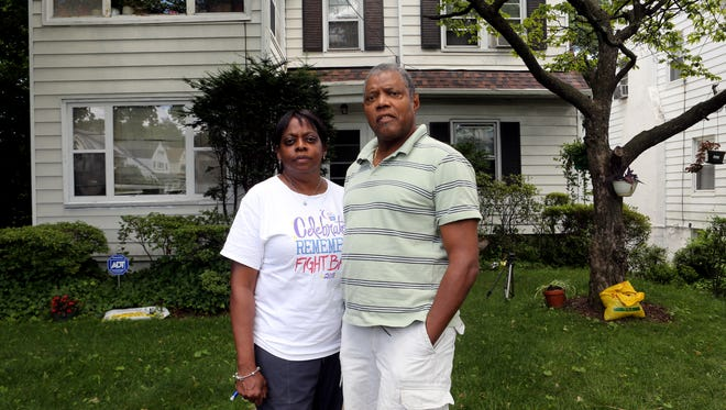 Gwynne and Clarence Youngs stand outside their house on Farrell Avenue in Mount Vernon.
