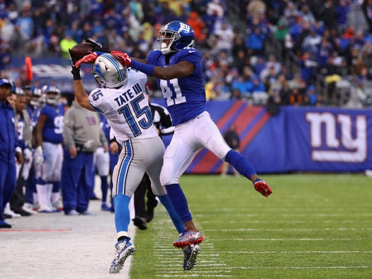 Golden Tate of the Lions attempts to make a catch against Dominique Rodgers-Cromartie New York Giants in the second quarter at MetLife Stadium on Dec. 18, 2016 in East Rutherford, N.J.