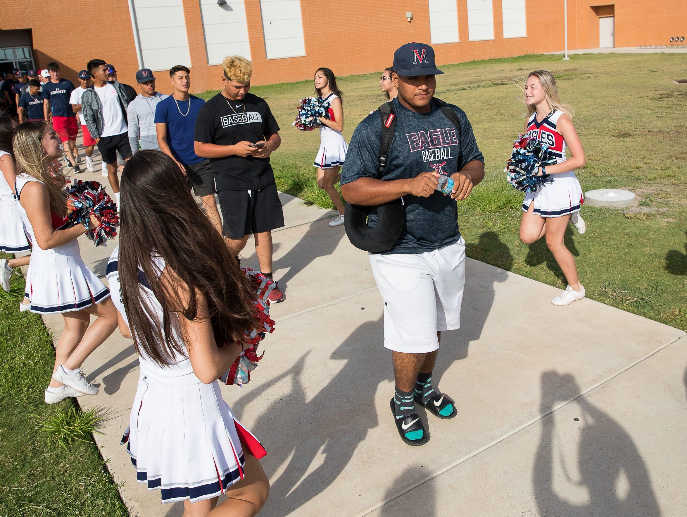 Veterans Memorial High School baseball team board a