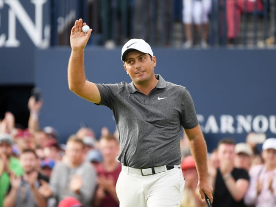 Francesco Molinari waves to the crowd after a birdie on the 18th hole during the final round of the 147th Open Championship at Carnoustie Golf Club in Carnoustie, Scotland.