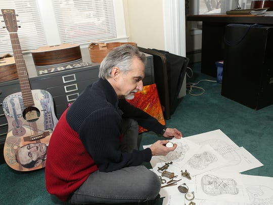 Rutherford resident and artist Robert Geotzl has designed the artwork for the 2 millionth Martin Guitar to be unveiled on January 18, 2017. He has designed for them before as well. Robert is photographed on Jan. 9, 2017.