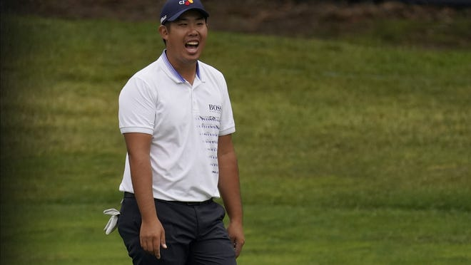 Byeong Hun An of South Korea reacts after a hole-in-one on the 11th hole during the final round of the PGA Championship on Sunday at TPC Harding Park in San Francisco.