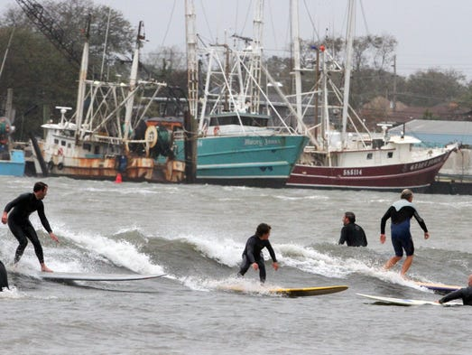 Surfers and stand up paddle boarders take full advantage