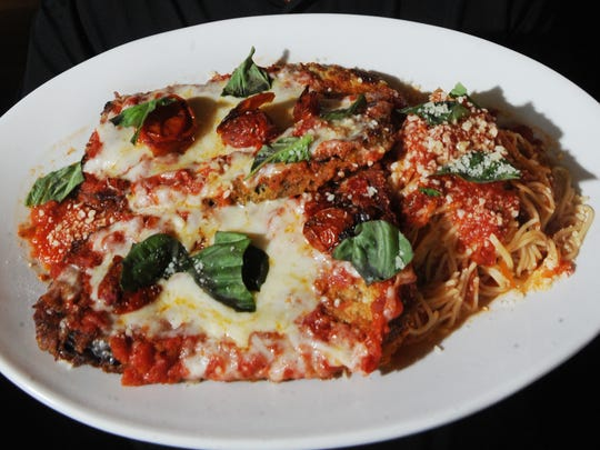 Eggplant Parmesan is a staple of the menu at Romano's Macaroni Grill in Simi Valley.