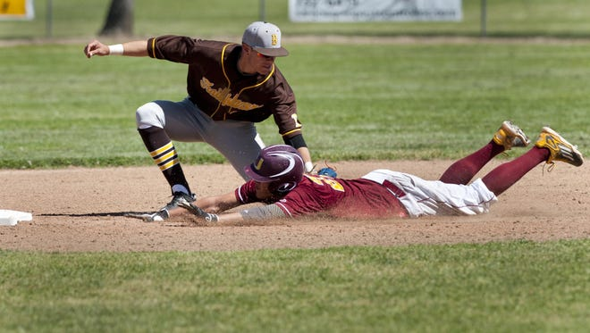Golden West's Wyatt Tilley outs Tulare Union's Ridge White at second in a Tulare-Visalia Baseball Invitational game on Tuesday, March 22, 2016.