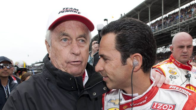 Roger Penske and Helio Castroneves on pit lane before  the running of the 97th Indianapolis 500, May 26, 2013 at the Indianapolis Motor Speedway.