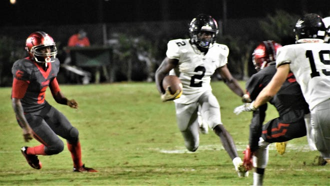 Richmond Hill receiver Jordan Clark (2) turns upfield during the Wildcats' 7-5 loss to the host Glynn Academy Red Terrors on Friday night in Brunswick.