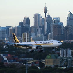 A Singapore Airlines Boeing 777 lands, right-side up, at Sydney Airport on May 13, 2014.