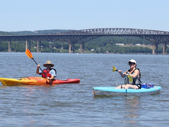 Robert and Cathy Waller of Fishkill paddle on the Hudson River near Long Dock Park in Beacon on July 9, 2018.