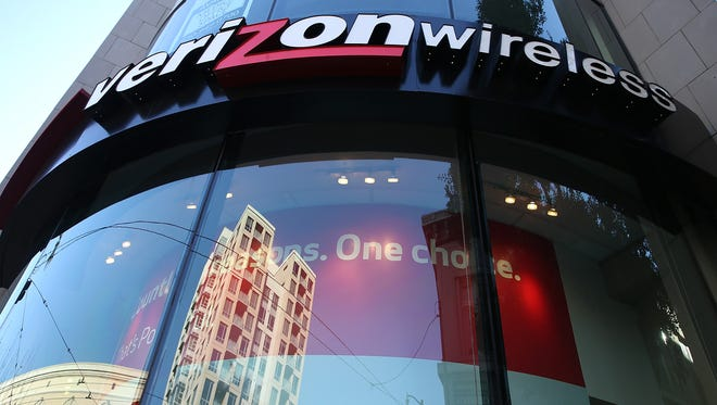 A sign is posted on the exterior of a Verizon Wireless store on January 22, 2015 in San Francisco, California.