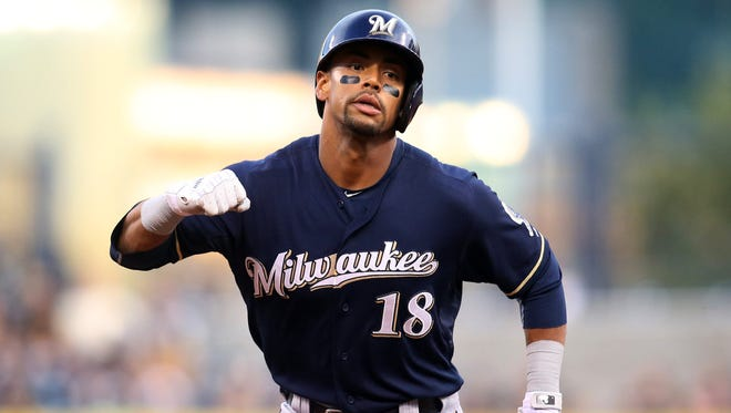 The Milwaukee Brewers have traded outfielder Khris Davis to Oakland for two prospects.