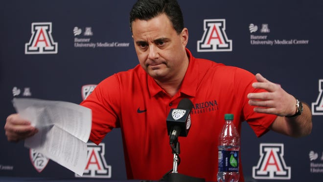 Sean Miller grabs his written statement off the table in a brisk manner after speaking about his future with the Arizona Wildcats basketball program at McKale Center on March 1, 2018, in Tucson, Ariz. Miller maintained he engaged in no wrongdoing in regard to allegedly paying a player, adding he looks forward to coaching the team this season.