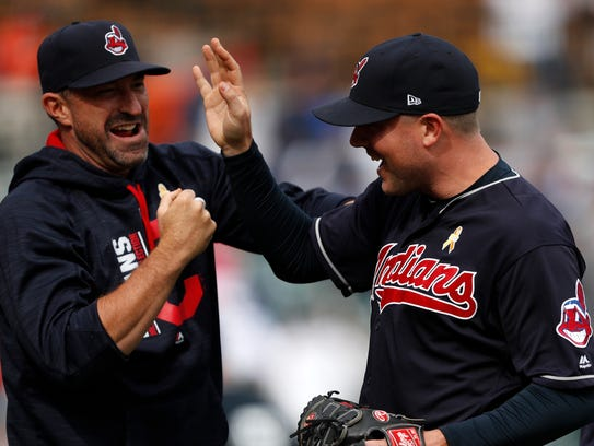 Indians relief pitcher Joe Smith celebrates with teammates