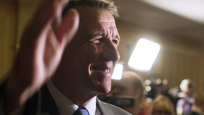 Gov.-elect Phil Scott waves to a room full of supporters at the Sheraton Burlington Hotel in South Burlington on election night, Nov. 8, 2016.