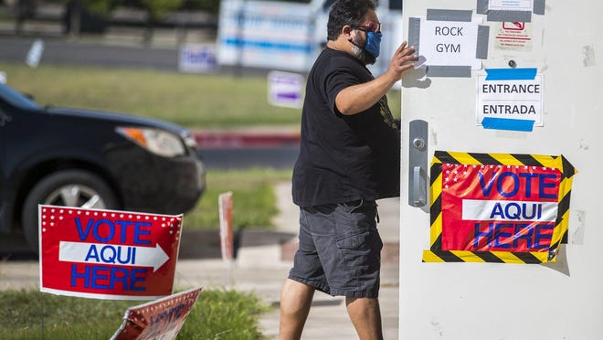 Voter Ed Martinez makes his way to Pflugerville school district's Rock Gym to vote in the primary runoff on July 14.
