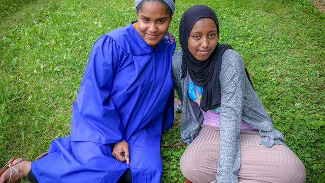 Kamar Gure of Providence (right) , and Juliana Camarena of Cumberland. Kamar was born in a refugee camp in Kenya, and Juliana's school counselor became her foster mother.