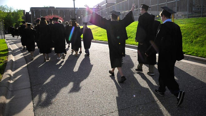 Sauk Rapids-Rice High School graduates get off the buses and walk to Halenbeck Hall for graduation on Tuesday. Most area high schools deal with questions about cheering and clapping at graduation ceremonies.