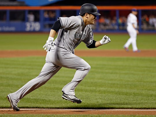 New York Yankees' Masahiro Tanaka runs home to score