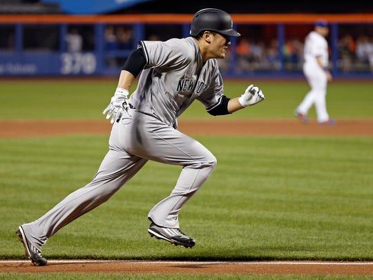 New York Yankees' Masahiro Tanaka runs home to score