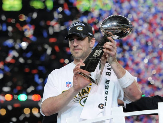 Green Bay Packers quarterback Aaron Rodgers holds the
