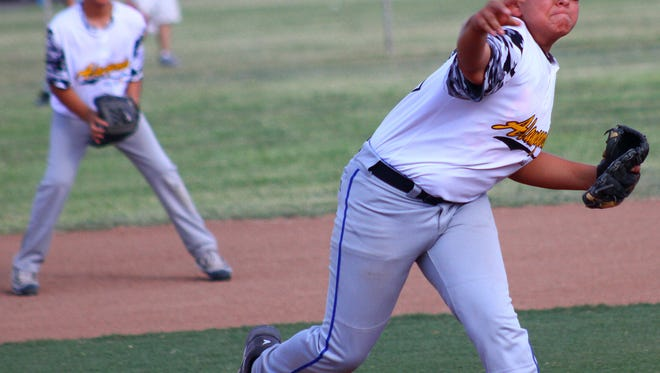Rotary Little League's Nicholas Martinez throws a pitch Monday night at the Griggs Sports Complex.