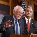 Senate Veterans' Affairs Chairman Sen. Bernie Sanders, I-Vt., left, accompanied by House Veterans' Affairs Chairman Rep. Jeff Miller, R-Chumuickla, speaks during a news conference on Capitol Hill in Washington on Monday to outline their agreement on a compromise plan to fix the vast health care system responsible for treating the nation's veterans.
