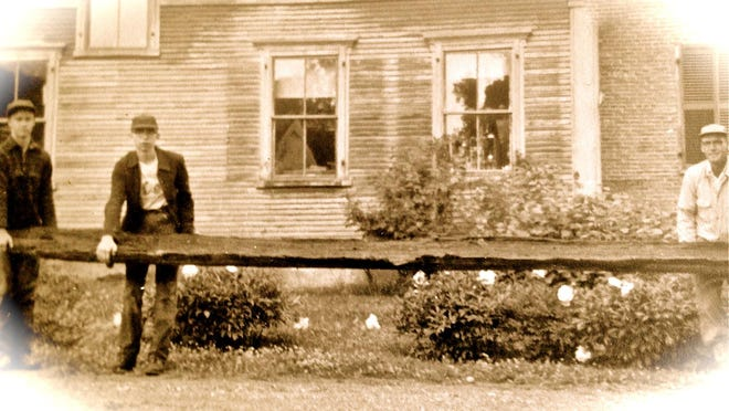 Lawrence and Ron Stancliff with Joe's canoe.