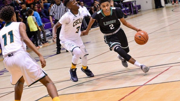 Lafayette High's Jalen Dalcourt (2) drives to the basket