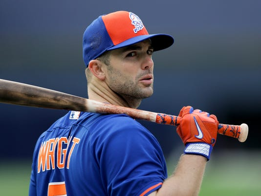FILE - In this May 6, 2016, file photo, New York Mets' David Wright watches during batting practice before the Mets played the San Diego Padres in a baseball game in San Diego. Wright says he's still hopeful to return to the major leagues even after surgery Tuesday, Sept. 7, 2017,  to fix the rotator cuff in his right shoulder, the latest setback in the 34-year-old's lengthy comeback attempt. (AP Photo/Gregory Bull, File)