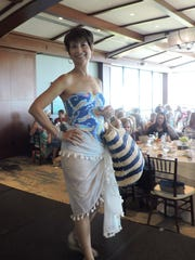 Gail Maidrand models fashions from J. McLaughlin at the Jo Covelli Fashion Show & Luncheon on March 5 at Sailfish Point Country Club.