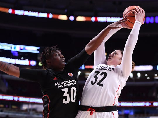 Mar 29, 2017; Chicago, IL, USA; McDonalds High School All-American West center Loretta Kakala (32) shoots the ball against McDonalds High School All-American East forward Rellah Boothe (30) during the second half at the United Center. Mandatory Credit: Mike DiNovo-USA TODAY Sports