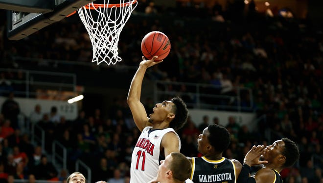 Mar 17, 2016: Arizona Wildcats guard Allonzo Trier (11) shoots the ball over Wichita State Shockers center Bush Wamukota (21) and forward Markis McDuffie (32) during the first half of a first round game of the 2016 NCAA Tournament at Dunkin Donuts Center.
